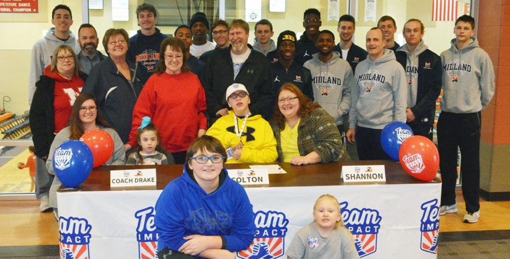 Midland Basketball Team Signs Very Special 12 Year Old Boy to Team