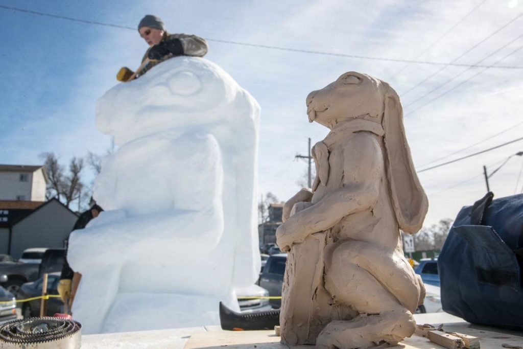 'We're just having fun': Snow sculptors brave the cold to chip, scrape and pack creations