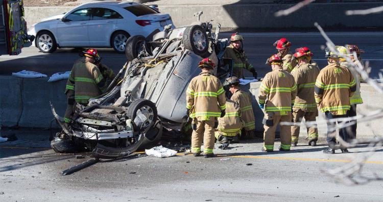 1 person killed after car smashes through fence, lands upside down on I-480 in Omaha