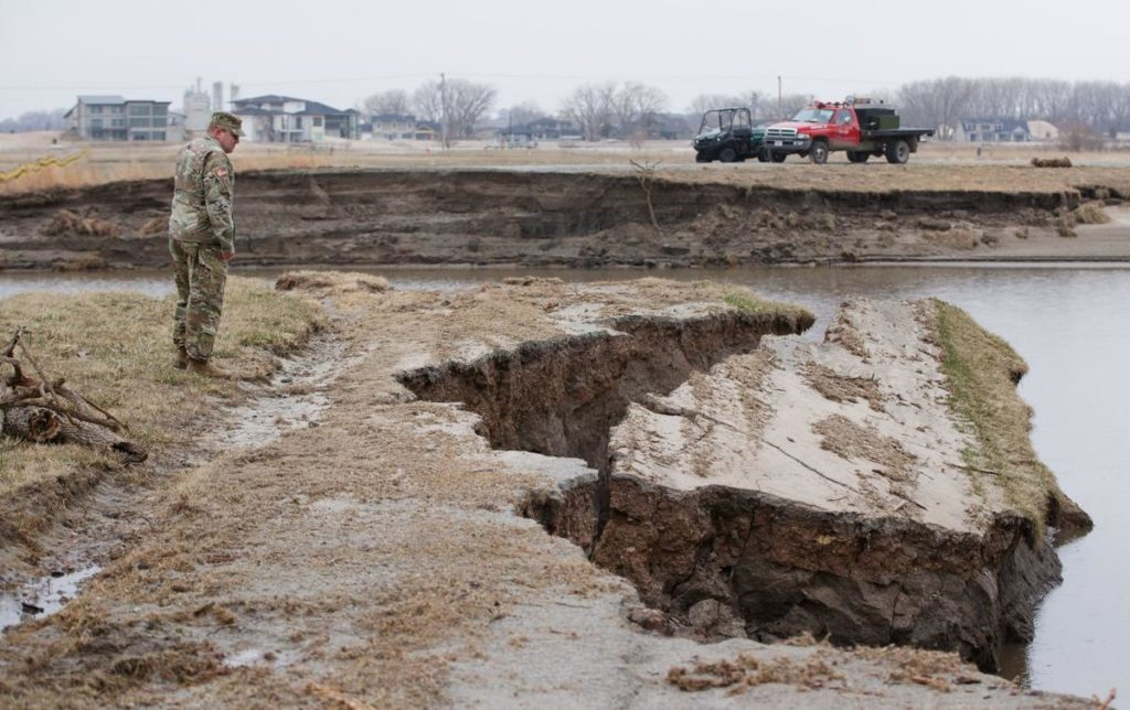 Floodwaters leave National Guard's top training camp a wasteland of sand and broken trees
