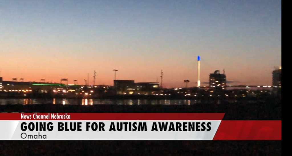 Bob Kerrey Pedestrian Bridge lit up blue for autism awareness