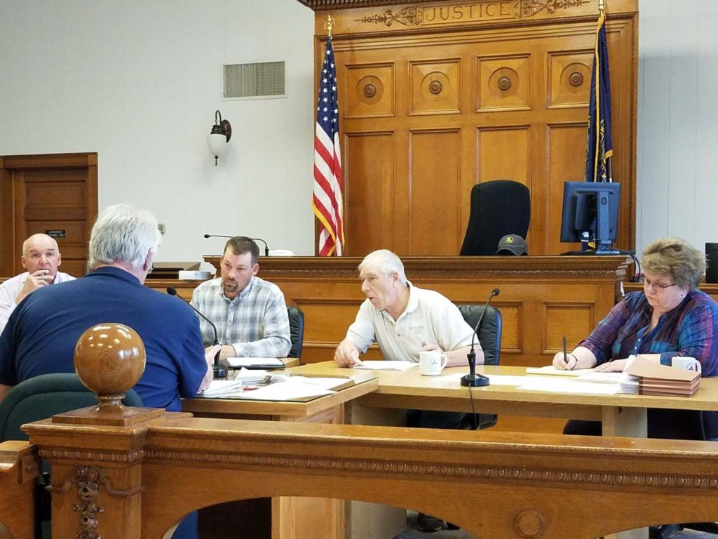 Year-Long Courtroom Table Discussion Tabled, Dump Truck Bid Approved