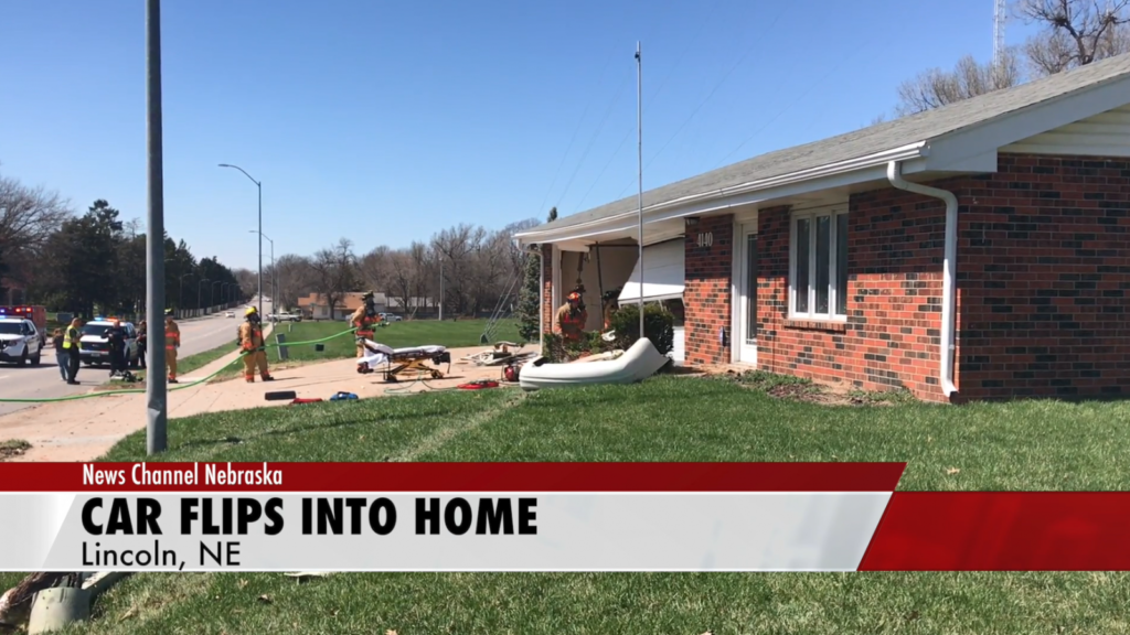 A car crashes and then flips into a Lincoln home
