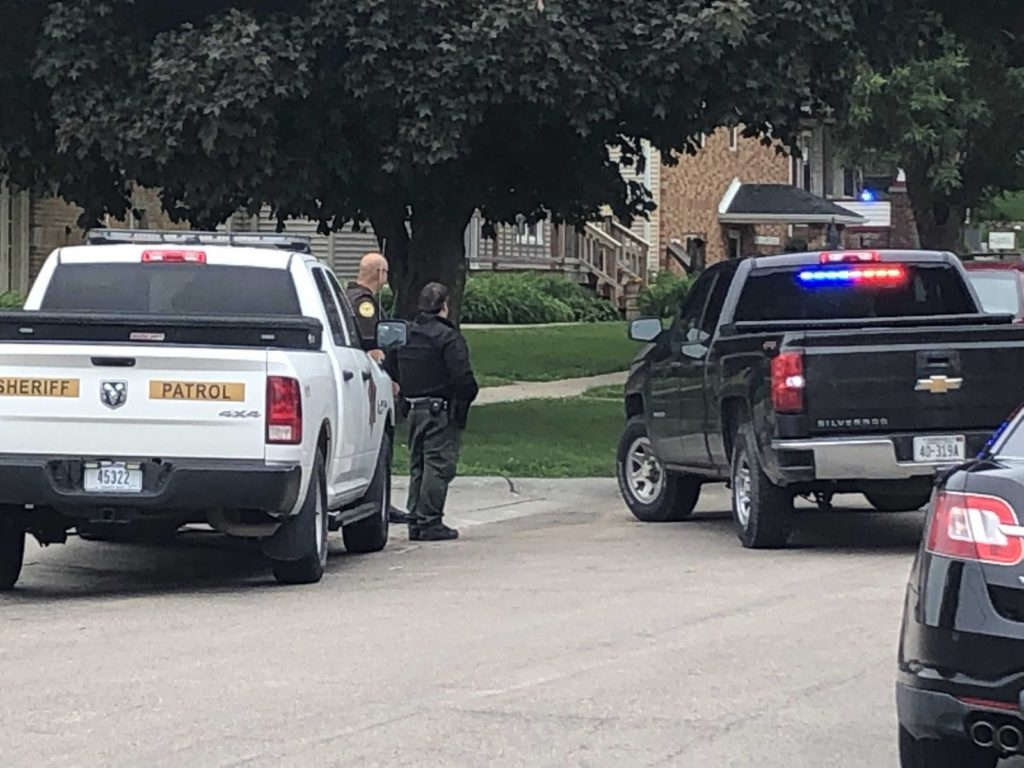Police have home surrounded after downtown shooting