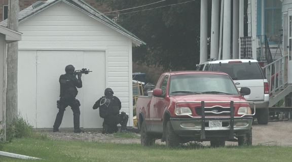 UPDATE: Police work to establish perimeter around house with shooter inside