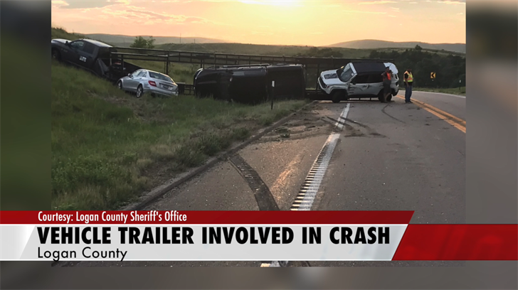 Car Trailer Swerves To Miss Oncoming Car And Spills Cars Across Road Near Logan-Custer County Line
