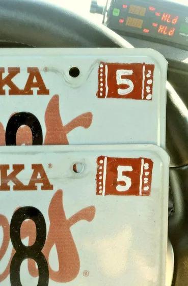 Nebraska driver cited for painting registration sticker on license plate