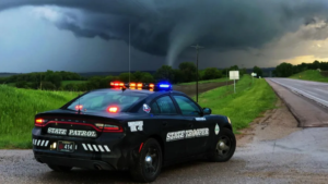 Photo of Nebraska State Patrol cruiser with tornado in the background near Dawson wins national contest
