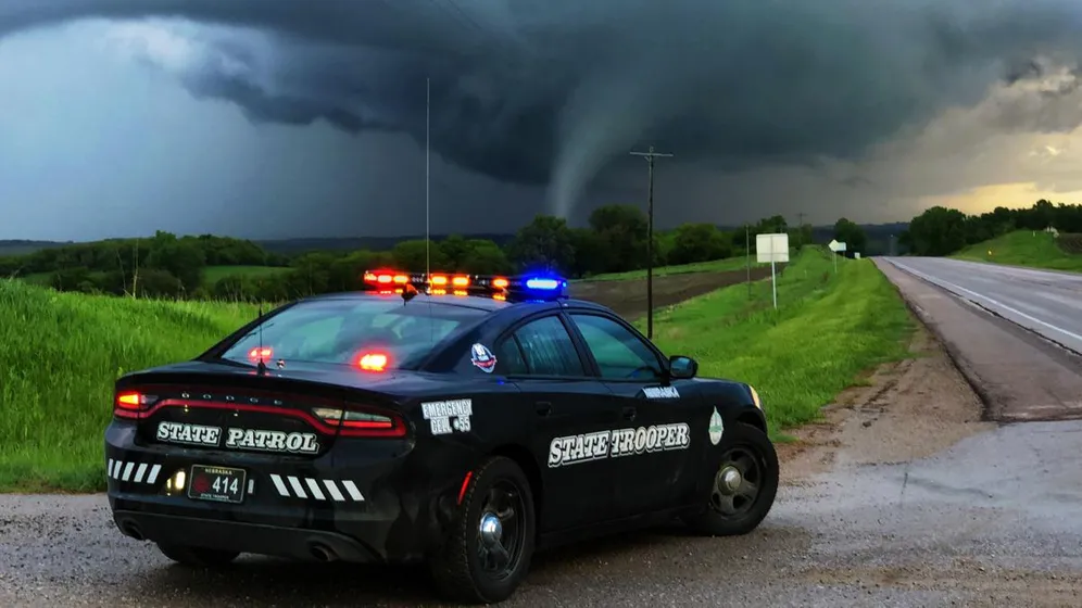 Photo of Nebraska State Patrol cruiser with tornado in the background near Dawson wins national contest
