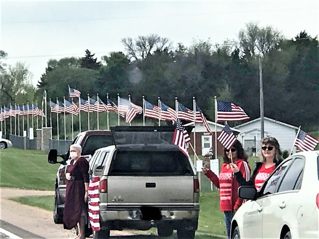 Flags Proudly Wave as We Say Goodbye to WWII Veteran R. Paul Robison