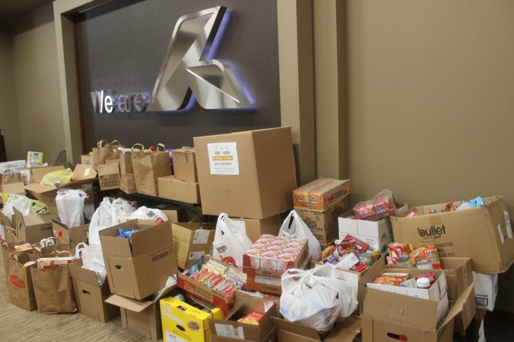 Over $7,000 & 4,500 items Donated During Adams Land & Cattle's Food 4 Youth Challenge