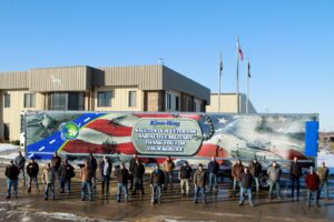 Veterans Of Great Dane Showcased In Front Kam-Way Transportation Trailer