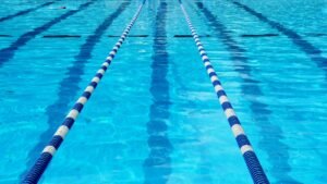 Broken Bow Cosmos Swim Team Competes at Kearney - Callie White Qualifies for Midwestern Championships